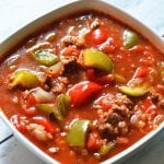This Crock Pot Stuffed Pepper Soup is a reader favorite and one of our most popular slow cooker recipes! Savory ground beef, sweet bell peppers and rice in a flavorful tomato broth. Yum! All the flavor of stuffed peppers with none of the work!