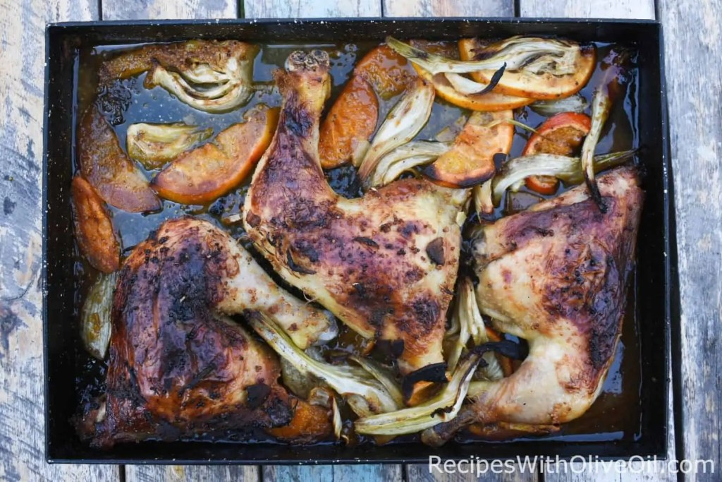 Roasted chicken fennel and citrus on baking tray