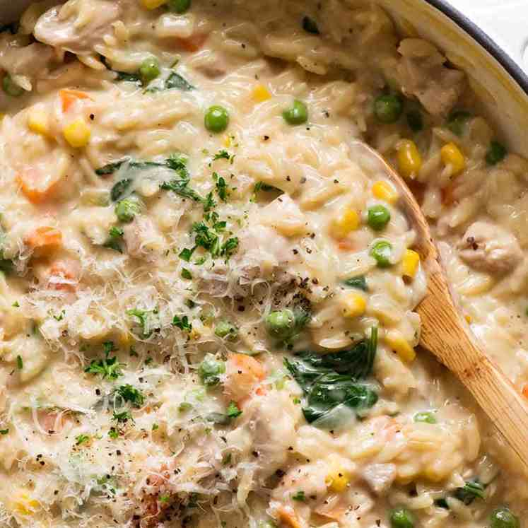 Creamy Chicken Vegetable Orzo in a skillet, fresh off the stove. Quick one pot chicken dinner - 15 minutes!