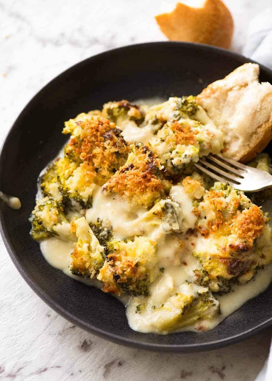 Creamy Garlic Parmesan Broccoli Casserole in a rustic dark bowl, ready to be eaten.