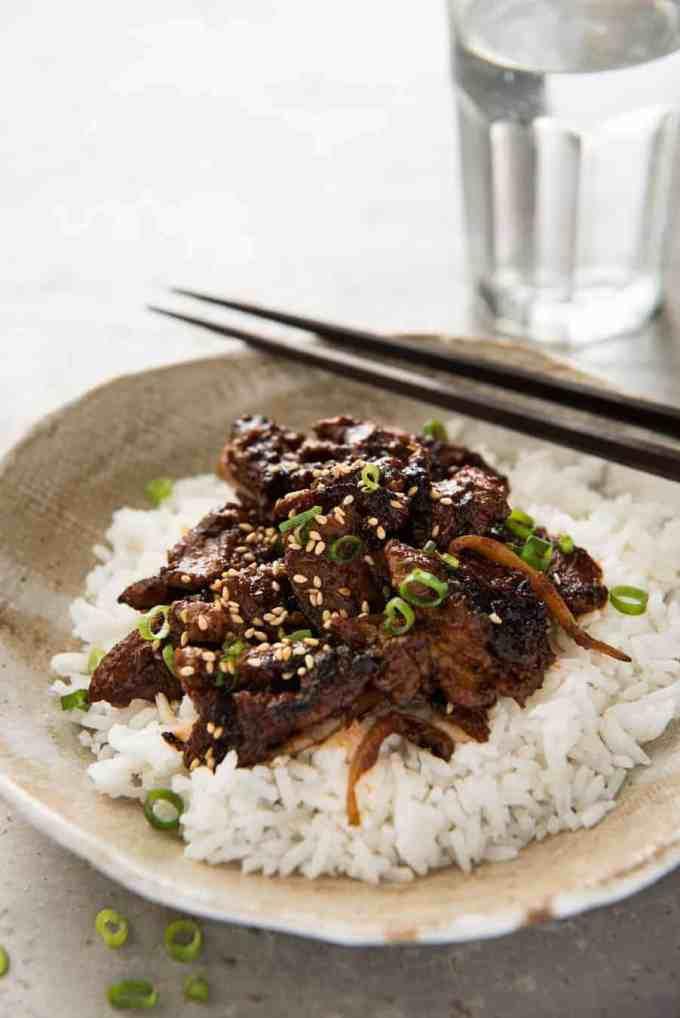 Spicy Korean Pork Stir Fry with chopsticks