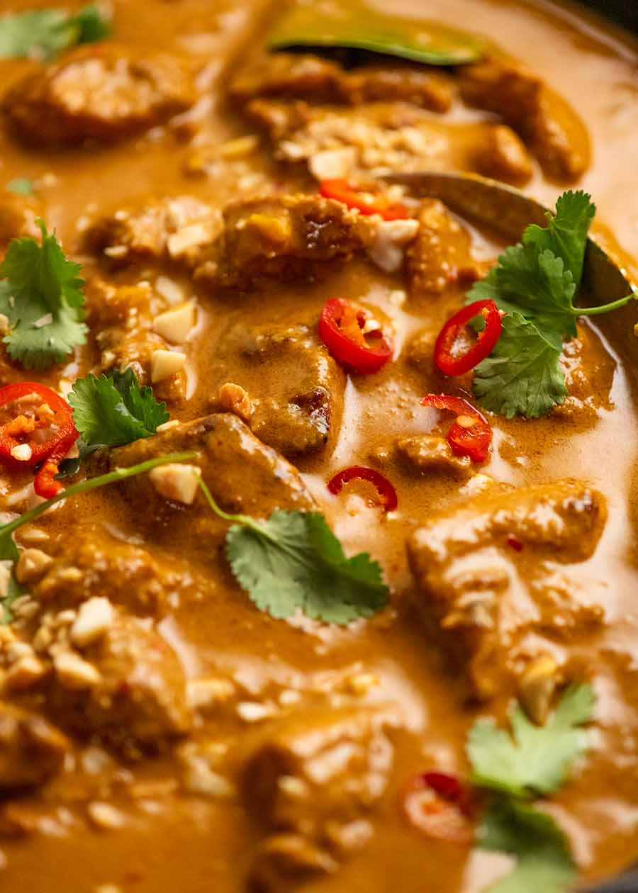 Close up of Chicken Satay Curry (Malaysian) in a skillet, fresh off the stove