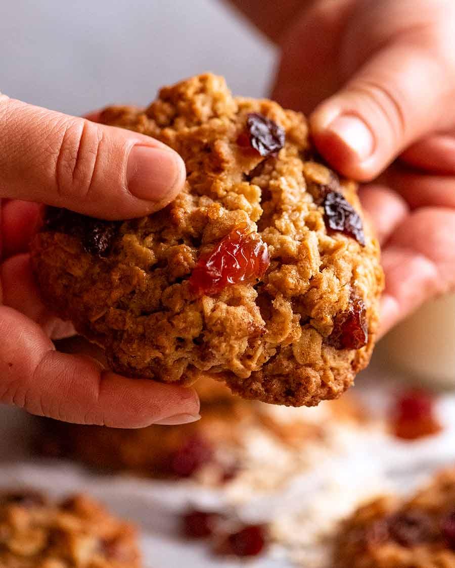Hand breaking Oatmeal Raisin Cookies