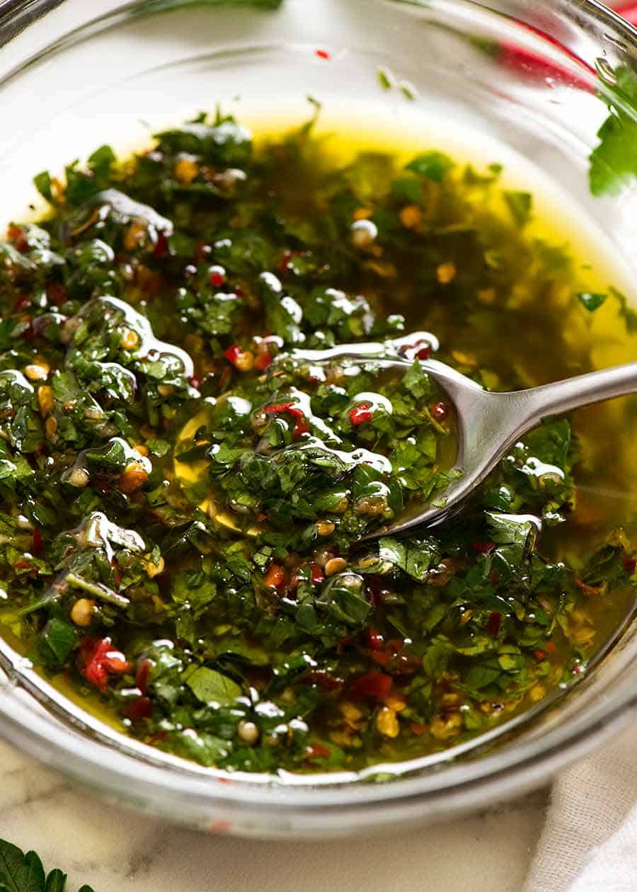 Close up of spooning Chimichurri Sauce