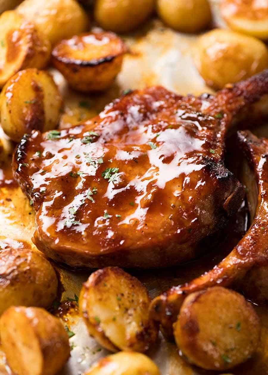 Close up of Oven Baked Pork Chops with potatoes, fresh out of the oven