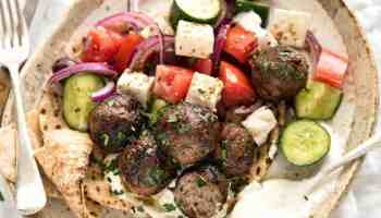 Soft, juicy, beautifully flavoured GREEK MEATBALLS! Serve as an appetiser with tzatziki, main with Greek Salad or make wraps! www.recipetineats.com
