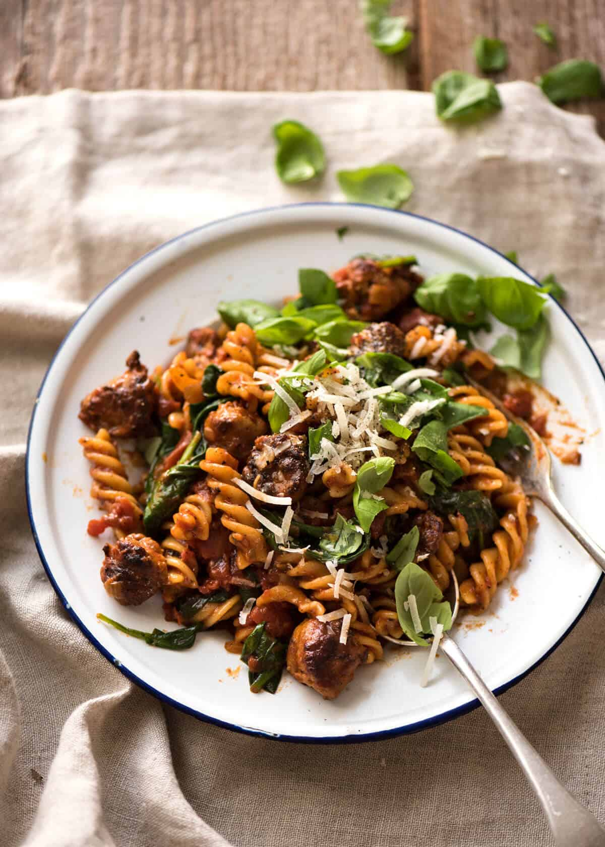 A quick and easy Sausage Pasta made using chopped up Italian sausages that look like meatballs! www.recipetineats.com