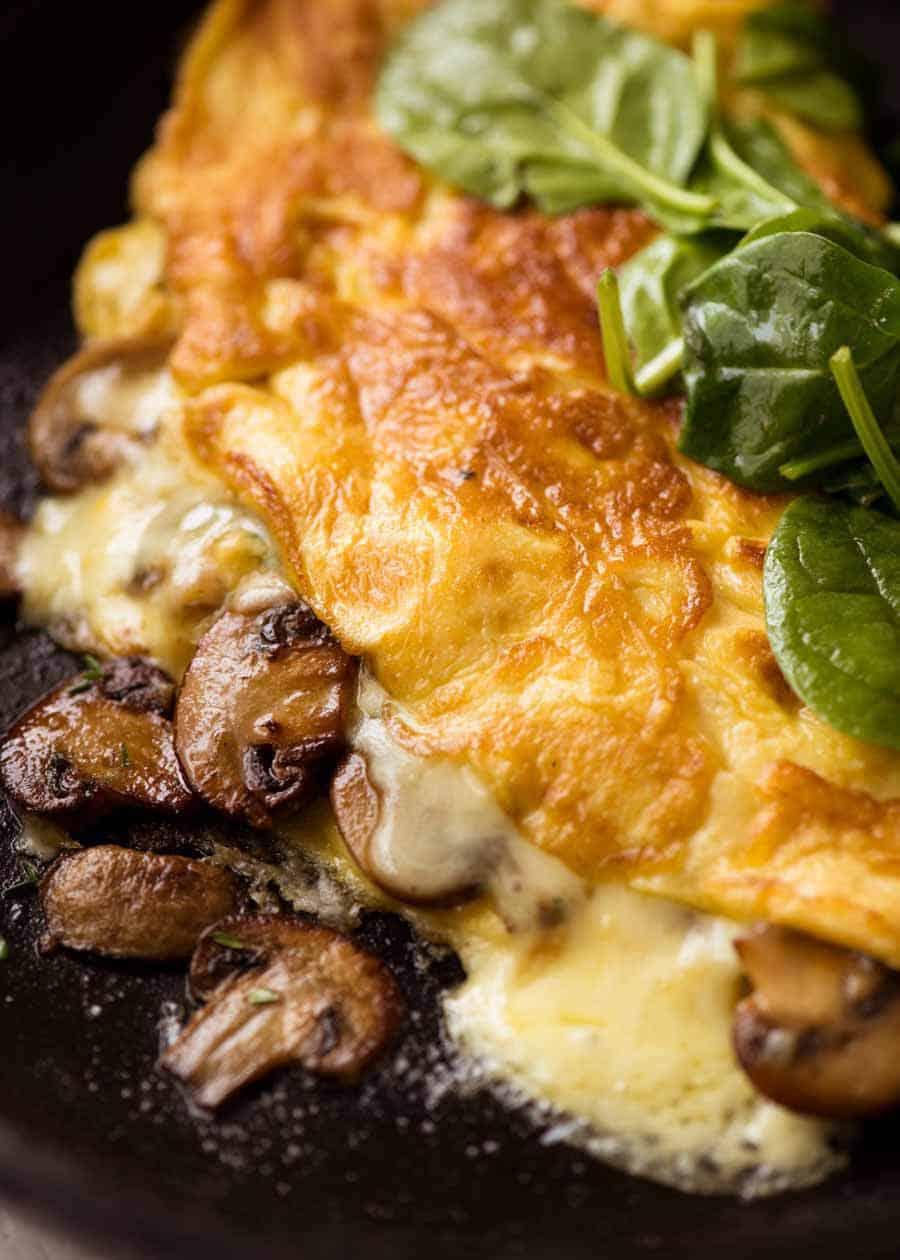 Close up of Cheesy Omelette with Garlic Butter Mushrooms