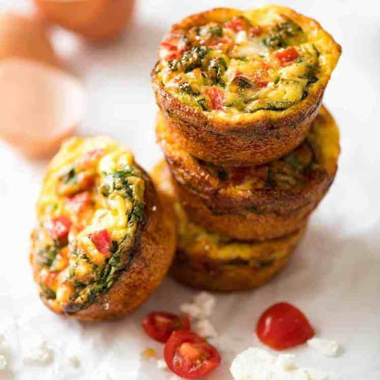 Healthy doesn't have to be bland! These Healthy Egg Muffins are a great grab & go breakfast option. Egg, spinach, feta, cherry tomatoes and bell peppers/capsicum. recipetineats.com