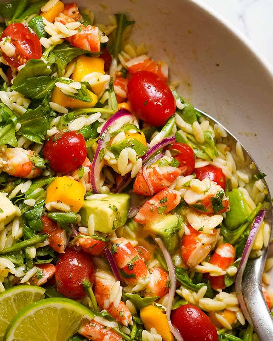 Close up overhead photo of Prawn Mango Avocado Summer Salad with Lime Dressing in a bowl, ready to be served