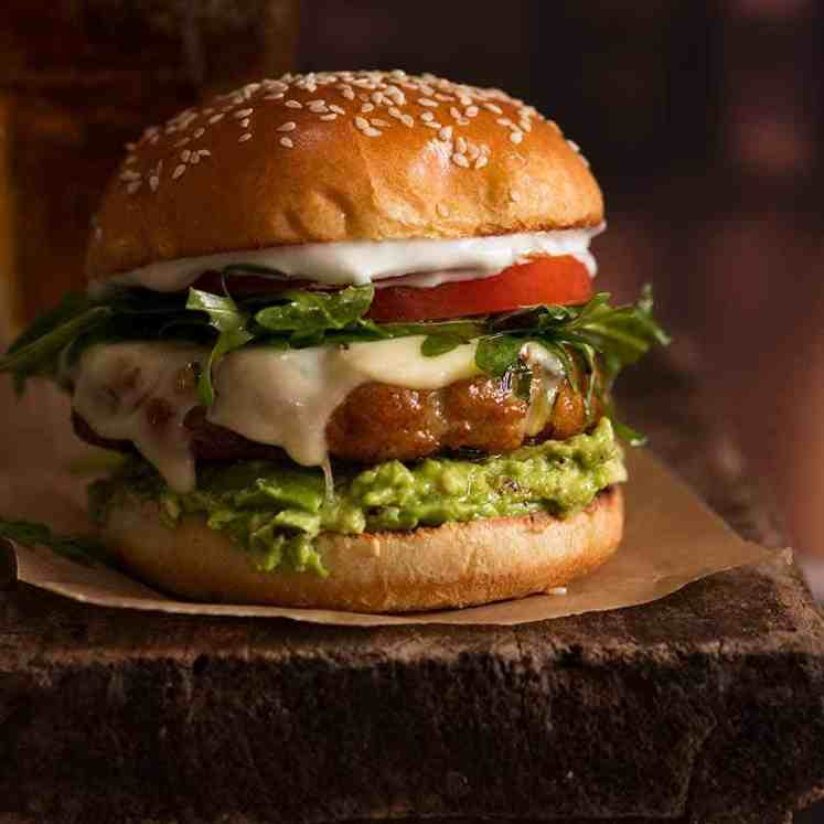 Close up of juicy, flavour loaded Avocado Chicken Burgers, ready to be eaten
