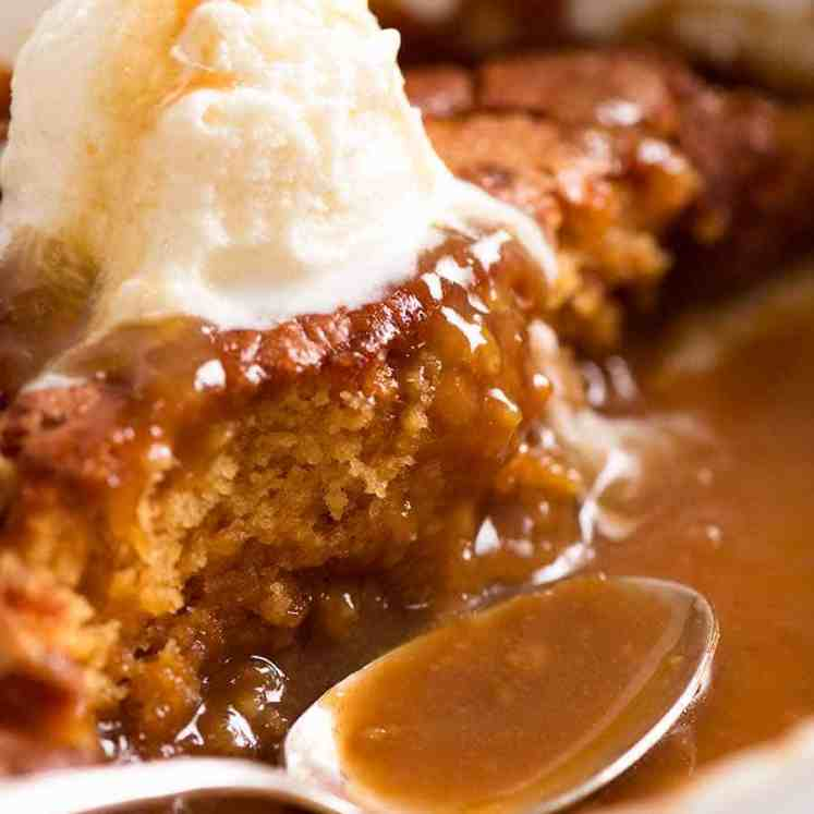 Close up of Self Saucing Butterscotch Pudding in a baking dish, being served