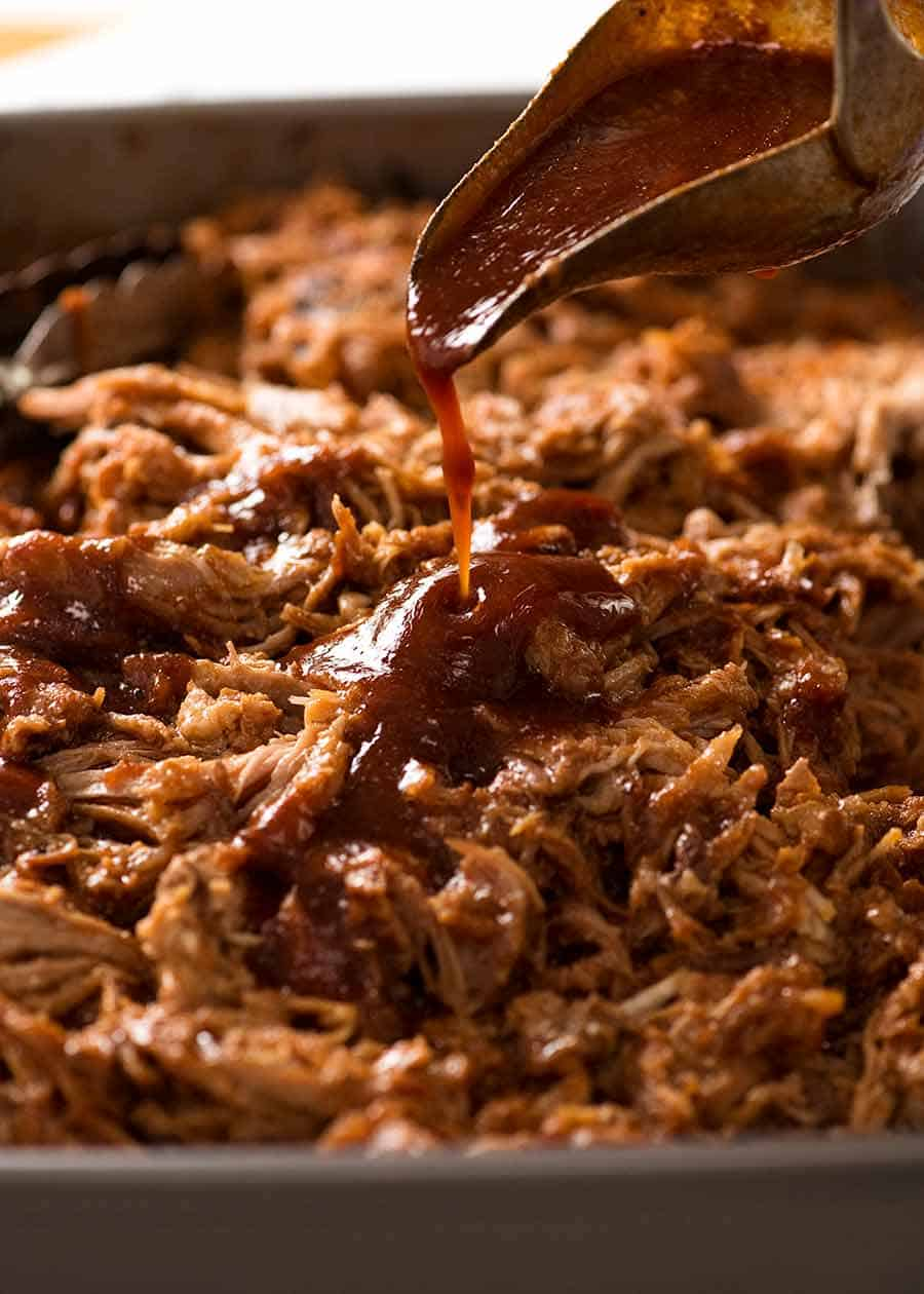 Pour homemade barbecue sauce over pulled pork