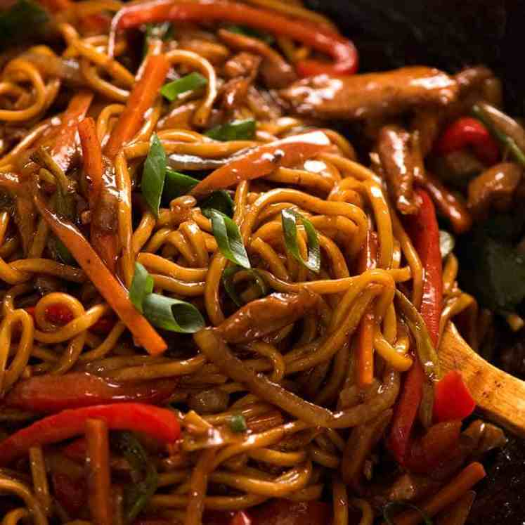 Close up of Lo Mein in a wok, ready to be served
