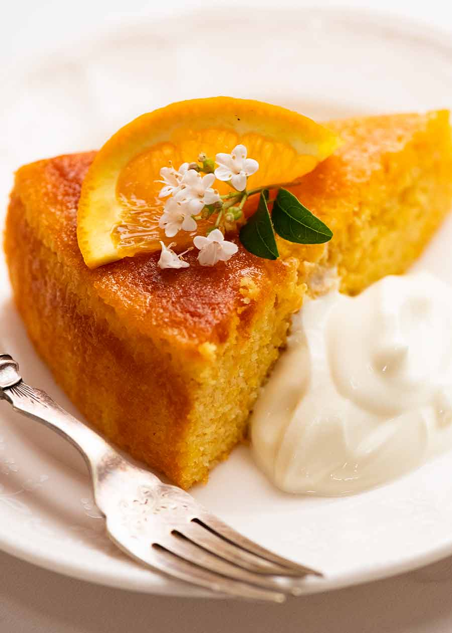 Close up of slice of Orange Cake, ready to be served