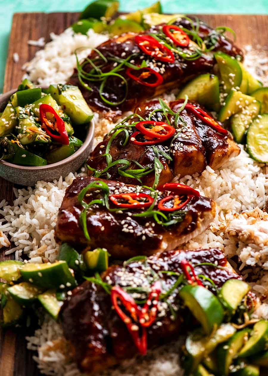 Asian Glazed Baked Barramundi on a platter with coconut rice and cucumber salad