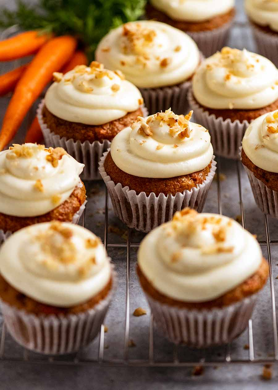 Carrot Cake Cupcakes with Cream Cheese Frosting on a rack, ready to be served
