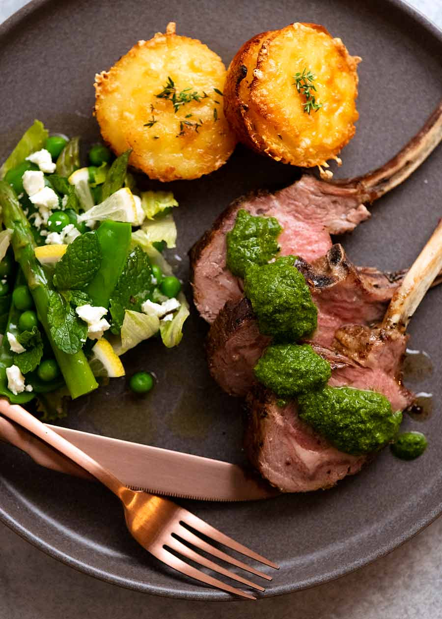 Rack of Lamb cutlets on a plate with salsa verde sauce