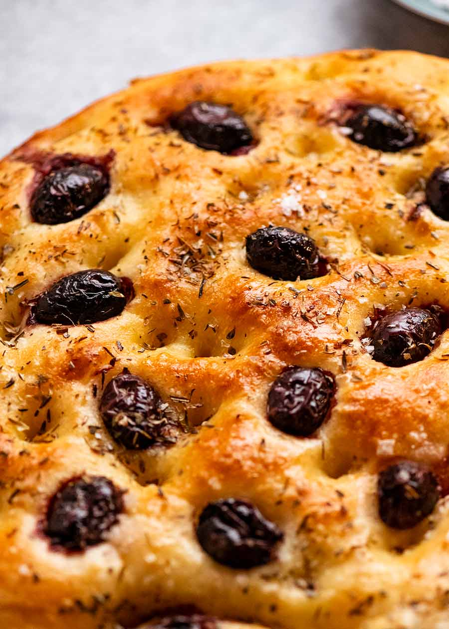 Freshly baked Olive Focaccia, ready to be sliced and served