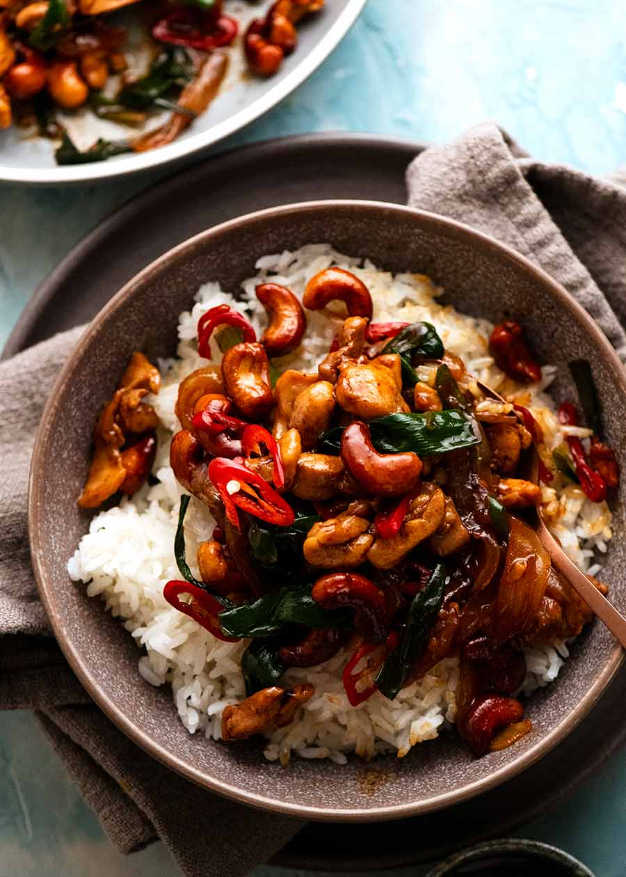 Thai Cashew Chicken Stir Fry on jasmine rice in a bowl, ready to be eaten
