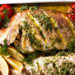 Freshly baked Whole Baked Fish with Garlic Butter Dill Sauce
