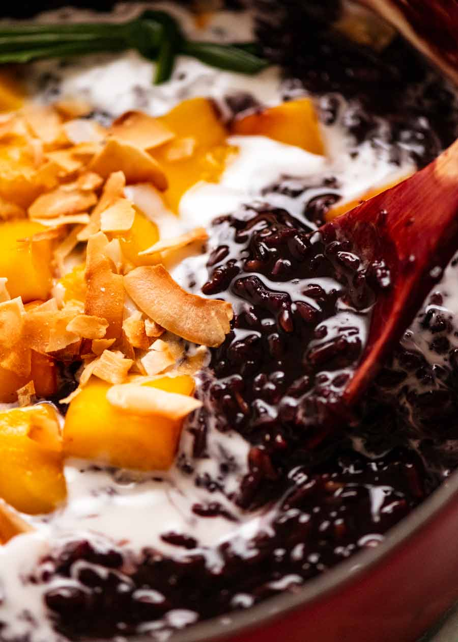 Close up of Thai Black Sticky Rice Pudding in pot with mango