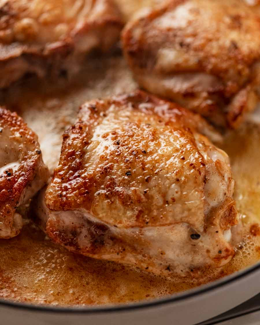 Close up of golden brown seared chicken thigh cutlets