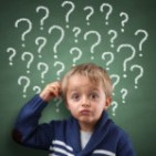 picture of a young boy with question marks behind his head