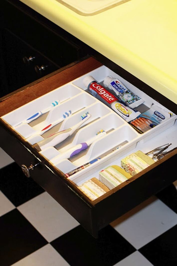 Use a silverware tray as a toothbrush holder