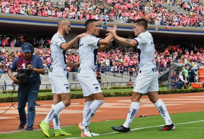 Pumas players celebrate a score