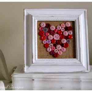 vintage buttons made into a heart on burlap in a reclaimed frame