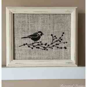 bird with a branch of berries painted on burlap in a reclaimed frame