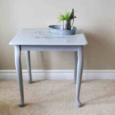 square grey side table with French graphic