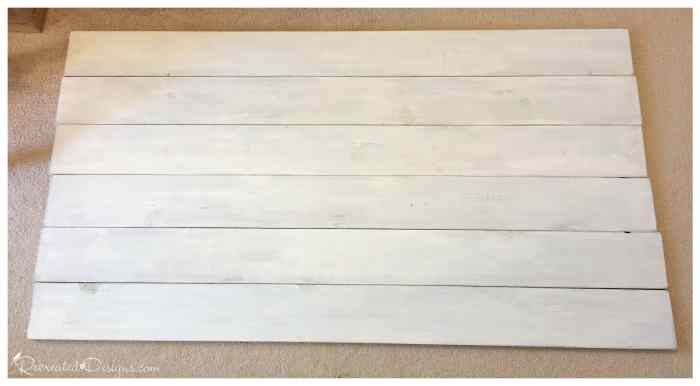painted pine boards being laid out to make a headboard