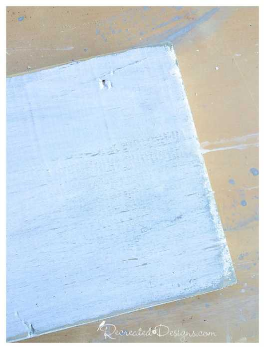 a pine board painted with Miss Mustard Seed Milk Paint in Shutter Grey and Ironstone