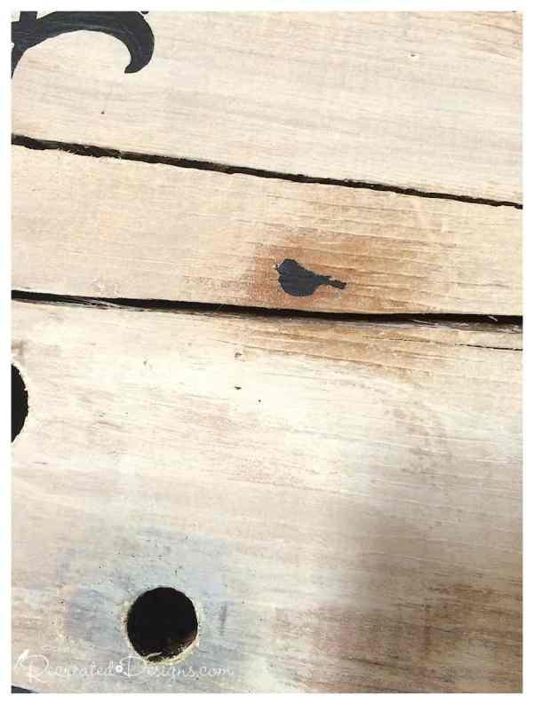 tiny-painted-bird-on-wood