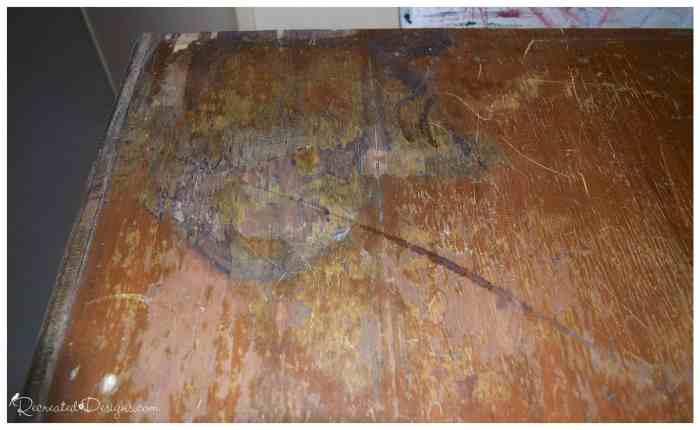 badly damaged veneer on an antique dresser