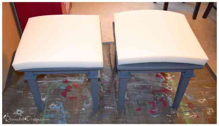 two piece of foam cut to fit the top of two painted side tables