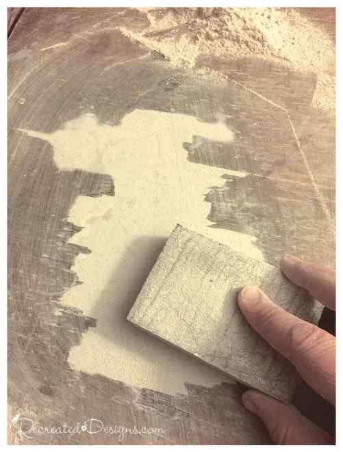 sanding down wood filler to fix missing veneer