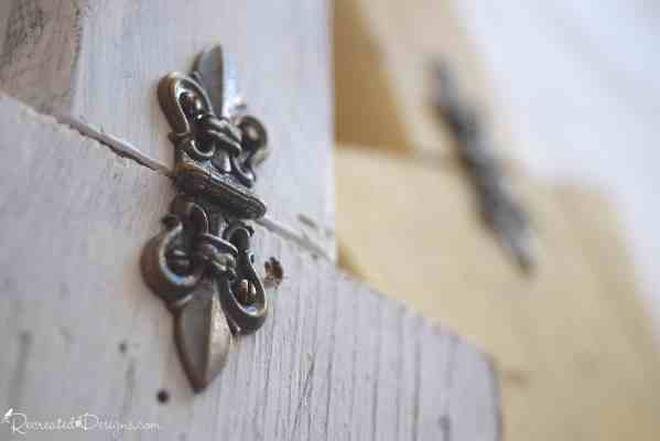 gorgeous vintage hardware on a piece of white painted wood