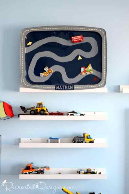 vintage TV tray painted with a road and shelves with vehicles