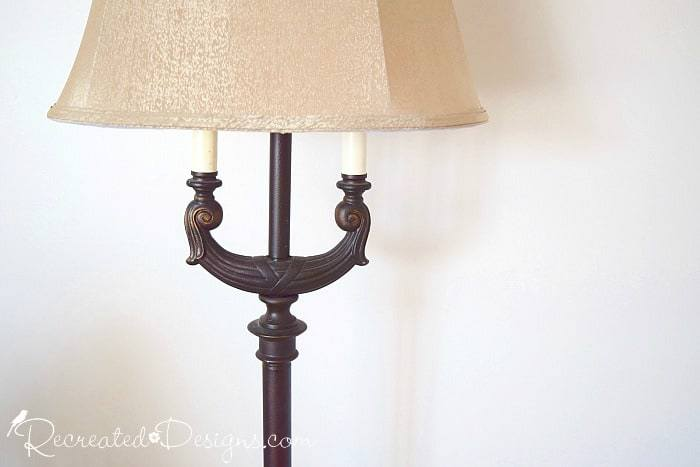 a vintage floor lamp before being recreated with paint and trim