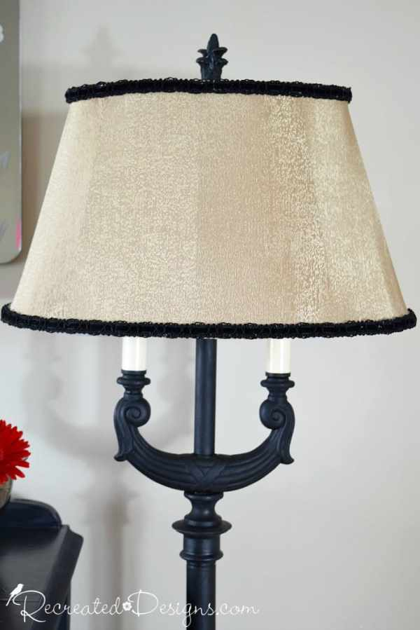vintage lampshade with black velvet ribbon added to it