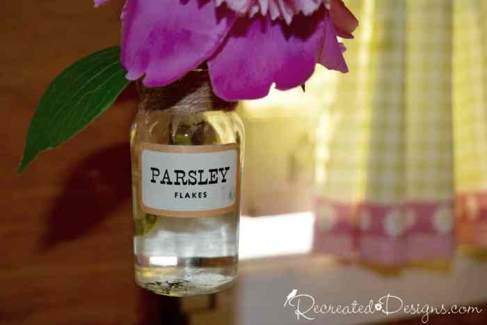 a beautiful pink peony in a vintage spice bottle