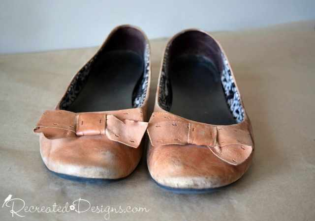 Peach coloured leather shoes in terrible shape