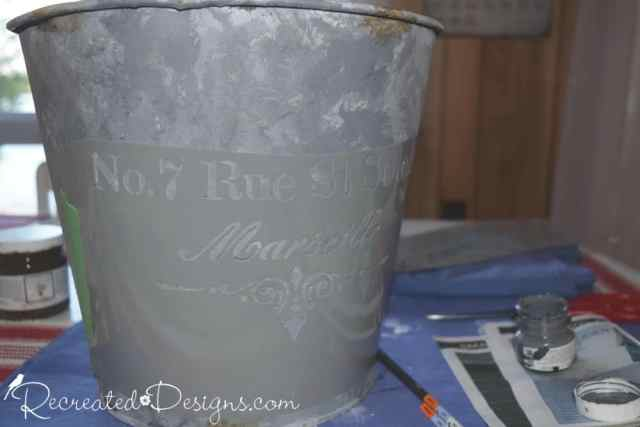 Using Frech Script stencil on a painted pail