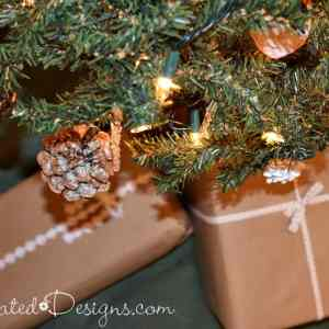 Christmas tree with rustic pinecones and packages