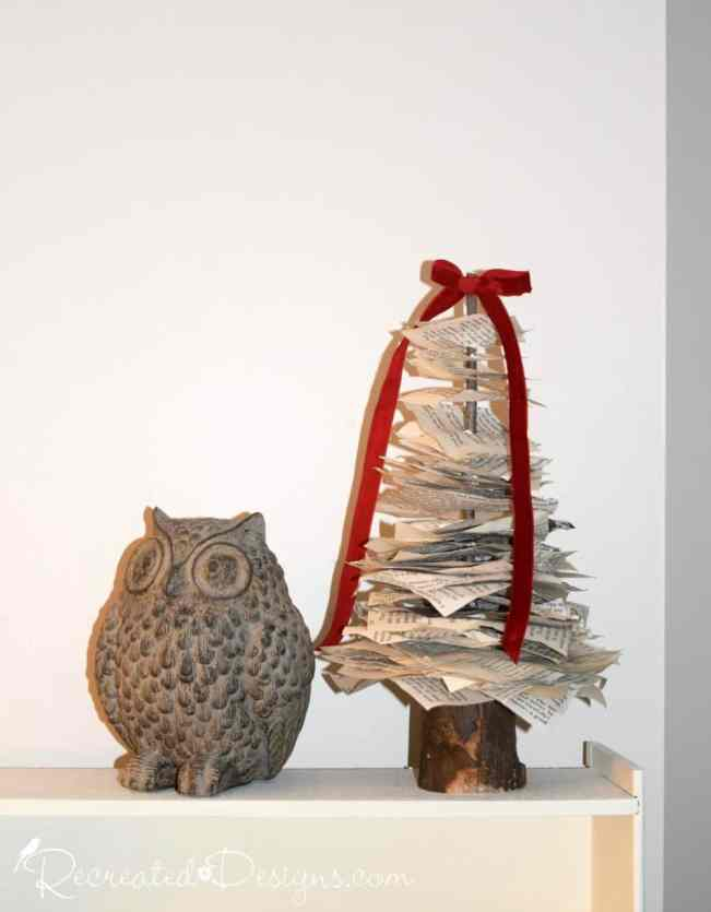 a paper tree next to an owl