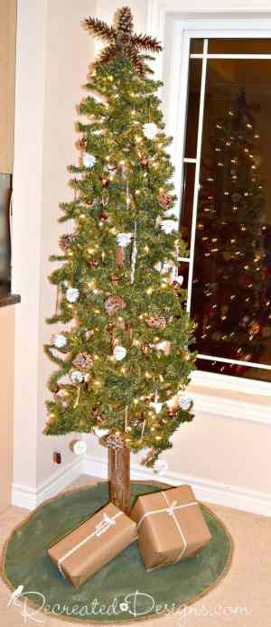 Christmas tree with handpainted muslin tree skirt with burlap ribbon trim