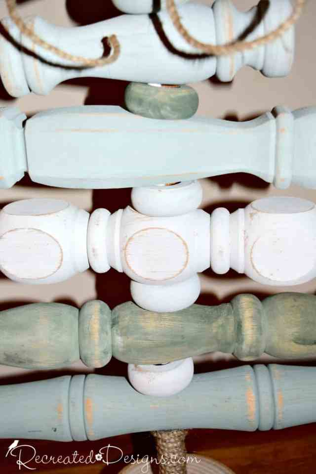 Green and white spindles painted with Country Chic Paint in Hollow Hill and Lazy LInen